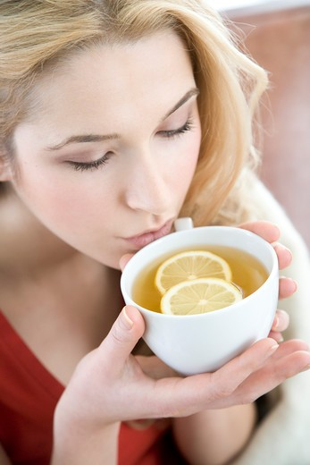 Stock Photo: 1841R-103550 woman drinking lemon tea