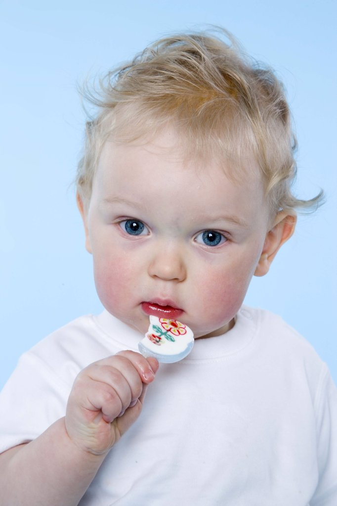 baby eating lollypop : Stock Photo