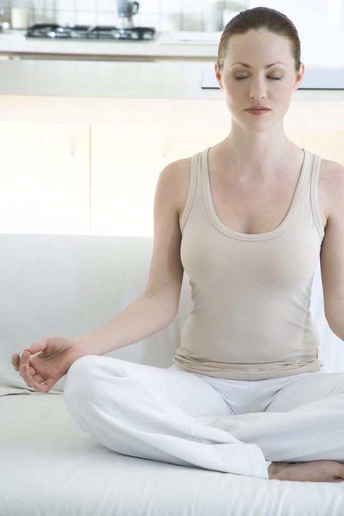 Stock Photo: 1841R-104724 young woman doing yoga