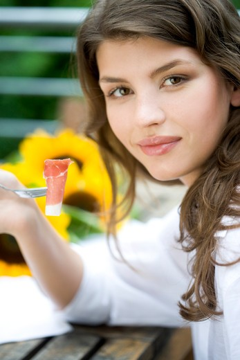 Stock Photo: 1841R-105182 Woman eating on the terrace