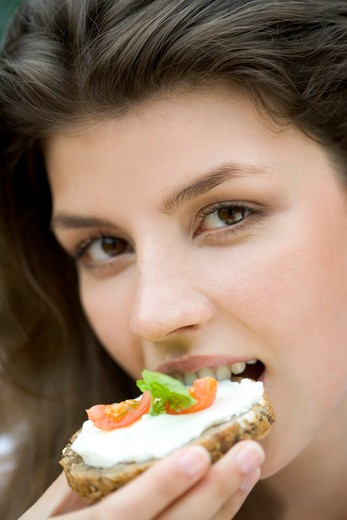 Young woman with sandwich : Stock Photo
