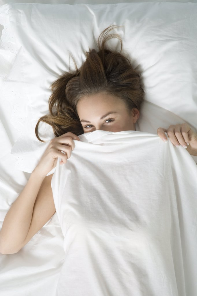 woman lying in bed : Stock Photo