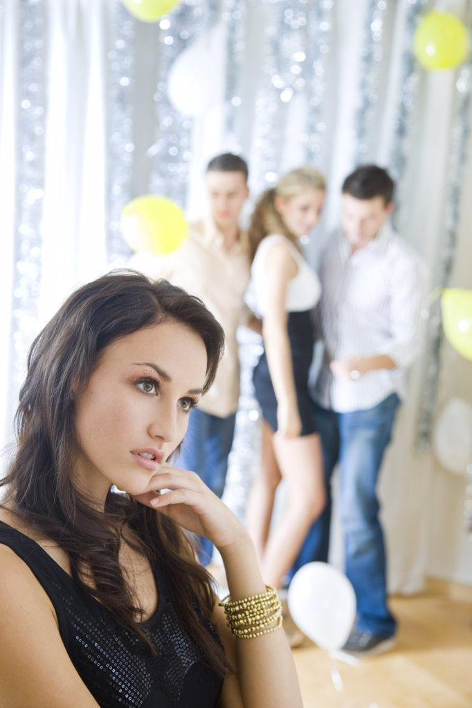 Stock Photo: 1841R-106888 sad woman at party