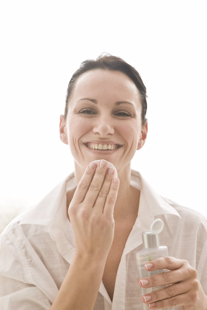 woman cleaning face with tonic : Stock Photo