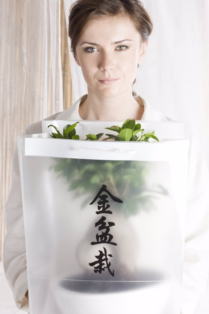 woman holding bonsai tree : Stock Photo