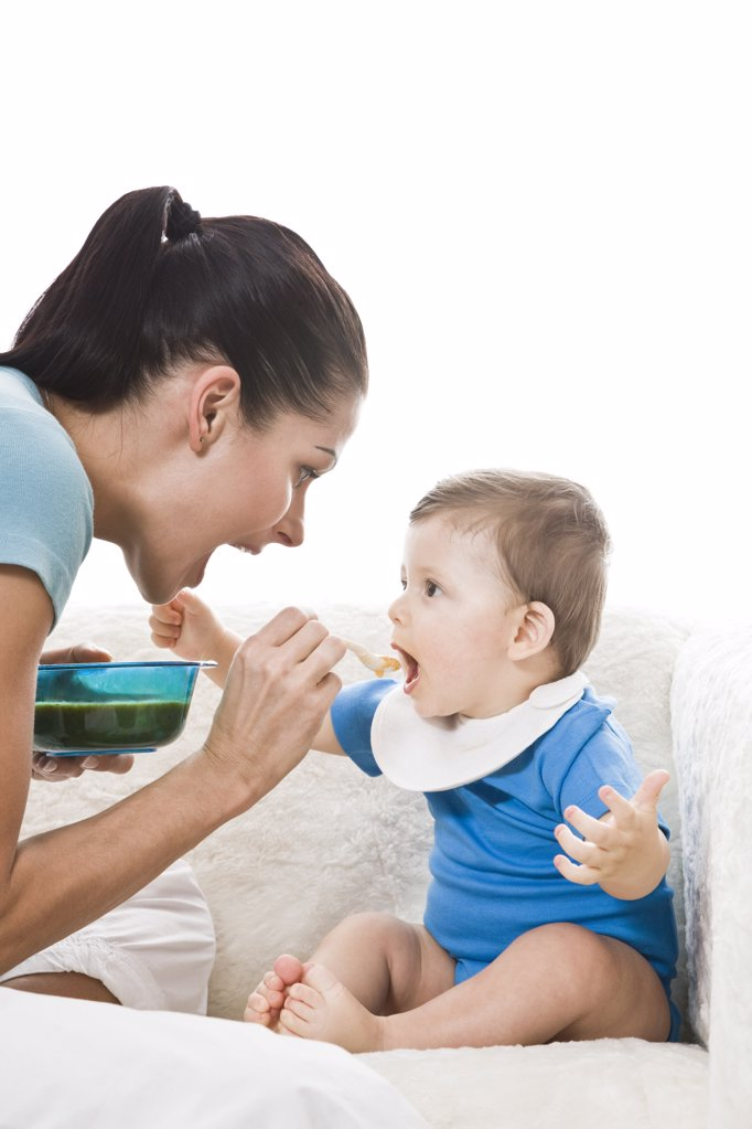 Stock Photo: 1841R-107507 Mother feeding baby in bib