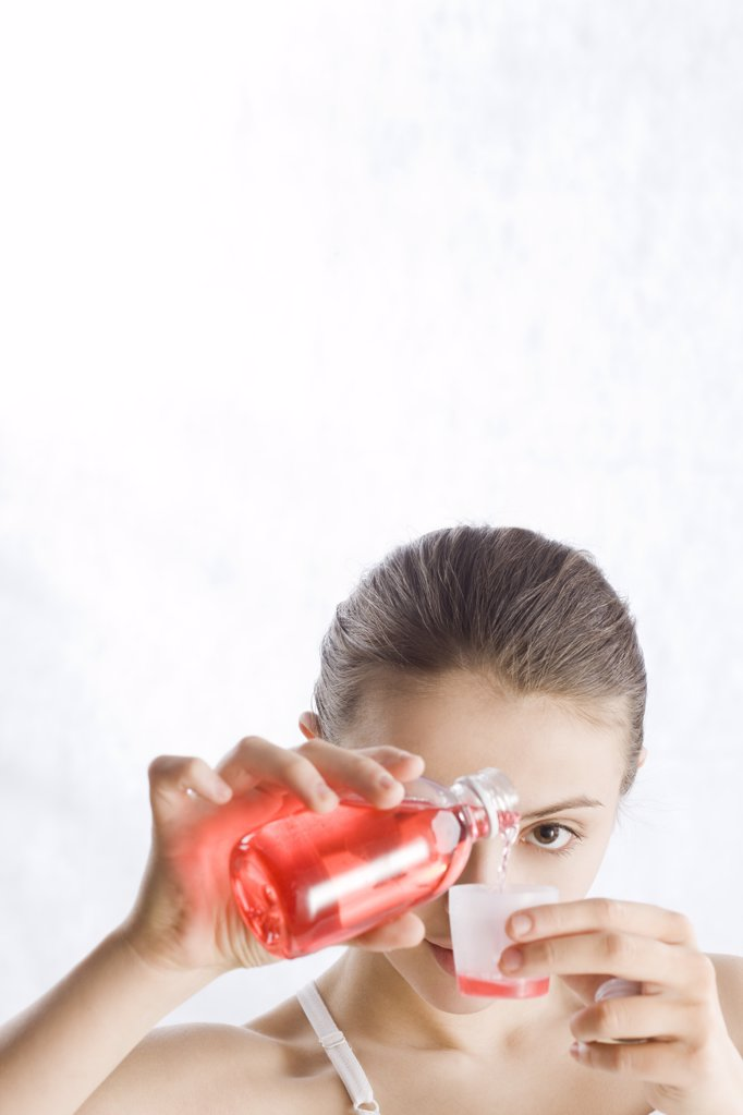 young woman pouring syrup : Stock Photo
