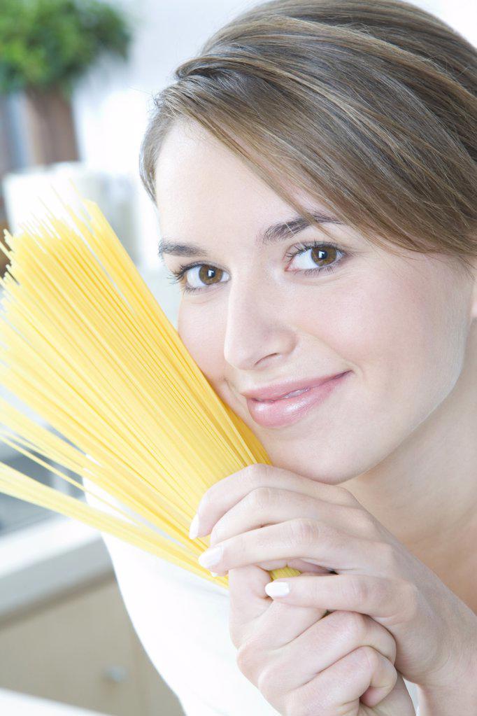 woman making spaghetti : Stock Photo