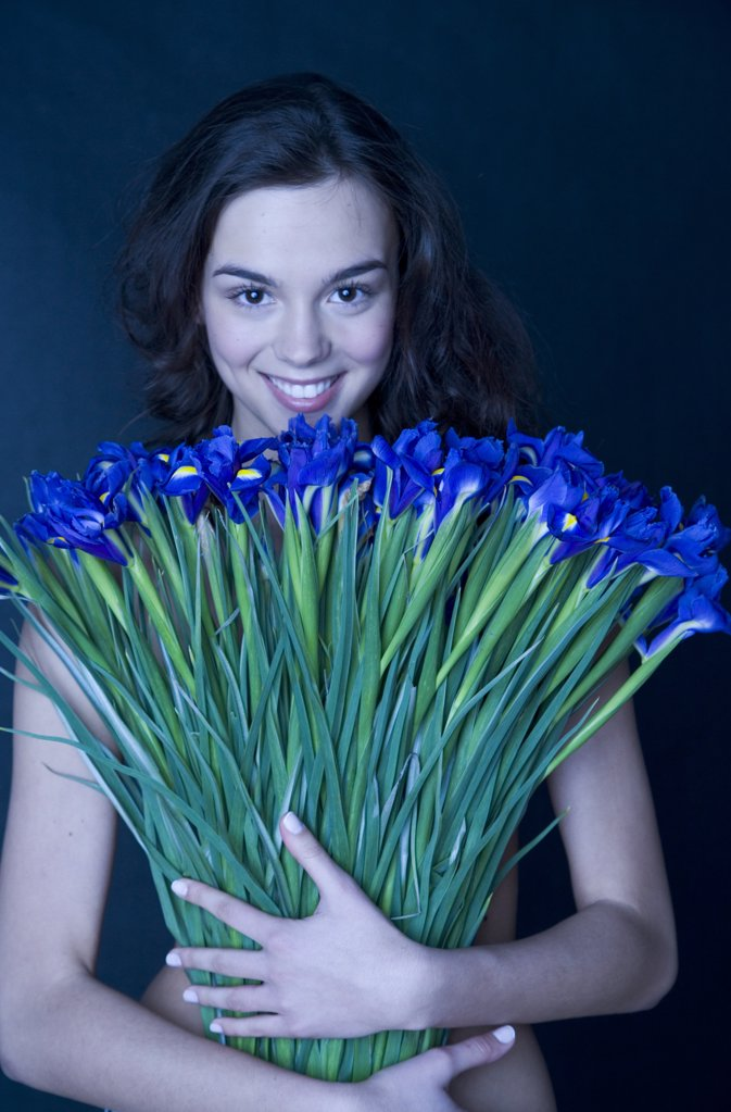 young woman with banch of irises : Stock Photo
