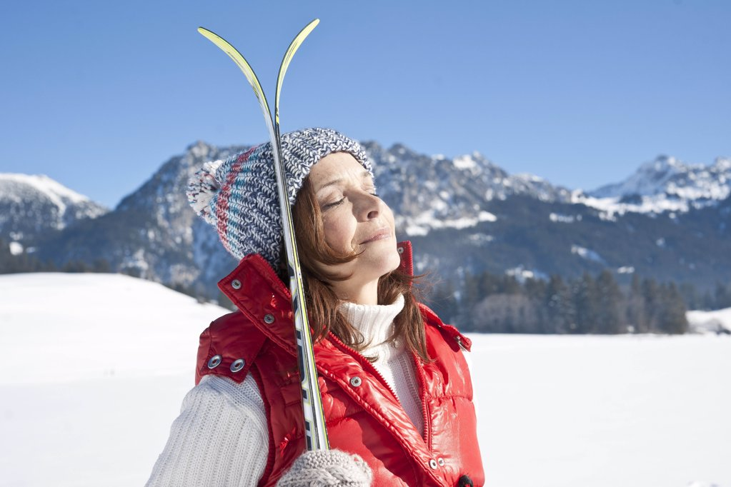 Stock Photo: 1841R-108477 Woman with skis in winter landscape, Tannheimer Tal, Tyrol, Austria