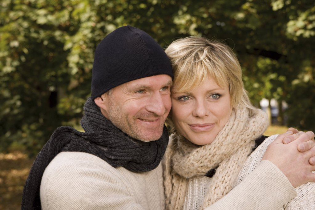 Happy couple embracing outdoors : Stock Photo