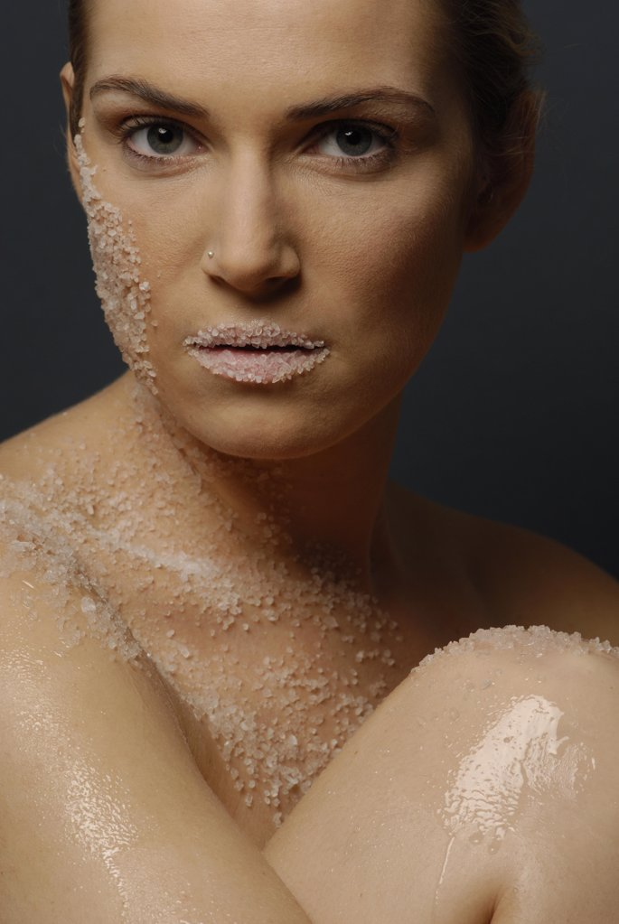 Stock Photo: 1841R-111912 Natural cosmetics : salt  - face of a young woman