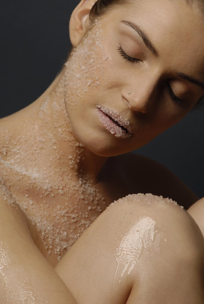 Stock Photo: 1841R-111914 Natural cosmetics : salt  - face of a young woman