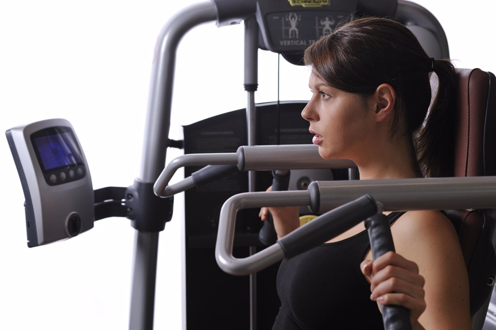 Stock Photo: 1841R-113533 young woman in a fitness center