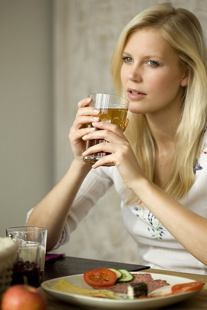 Young woman with tea glass : Stock Photo
