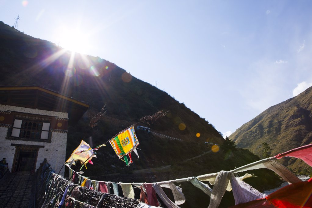 Stock Photo: 1841R-113775 House with bridge and prayer flags, Bhutan