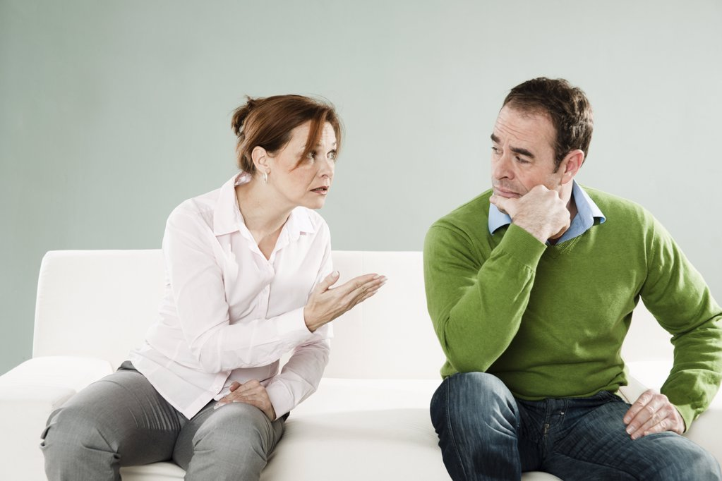 Mature couple on couch having an argument : Stock Photo
