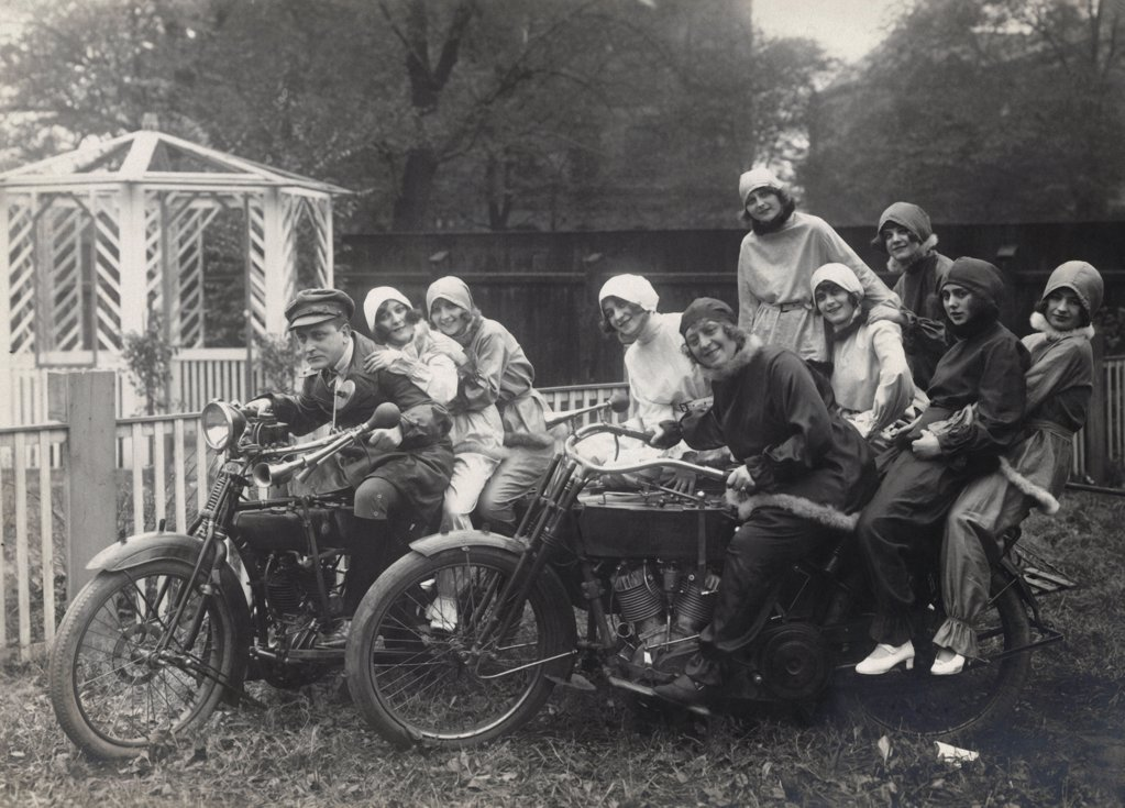 Historical picture of young people sitting on Motorbikes : Stock Photo