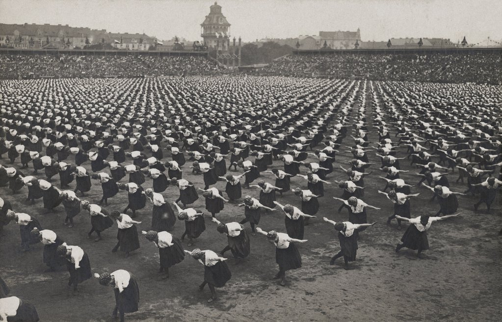 Stock Photo: 1841R-117083 Historical picture of women doing gymnastics in a stadium