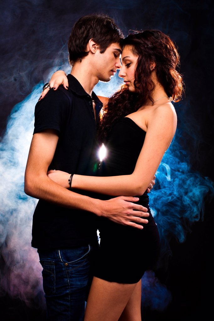 Stock Photo: 1841R-124820 Young couple embracing