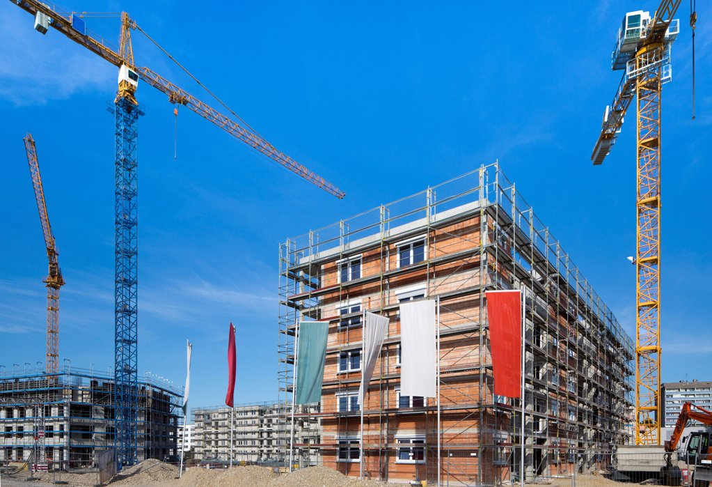 Cranes on a construction site : Stock Photo