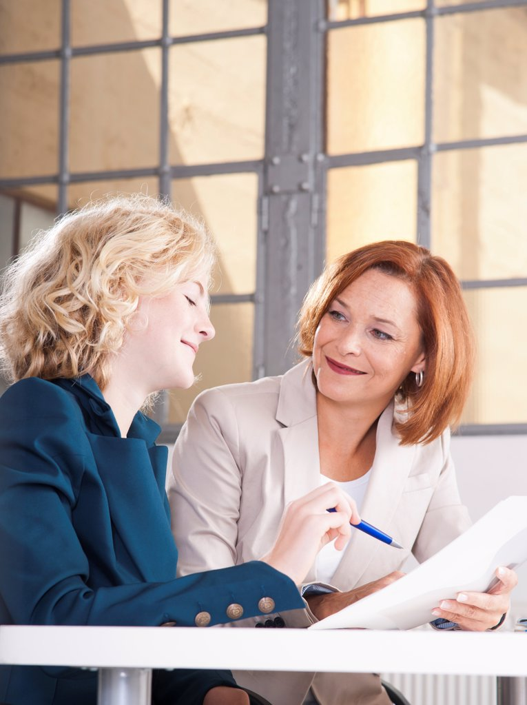 Stock Photo: 1841R-124940 Apprentice and female in office