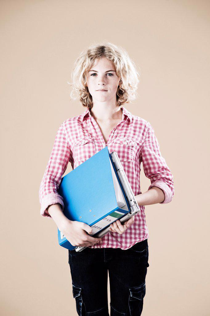 Stock Photo: 1841R-124946 Teenage girl with folder