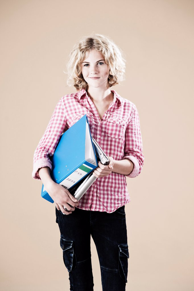 Stock Photo: 1841R-124947 Teenage girl with folder