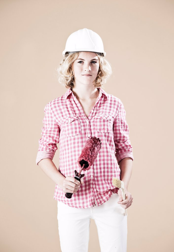 Stock Photo: 1841R-124951 Teenage girl with hard helm and brush