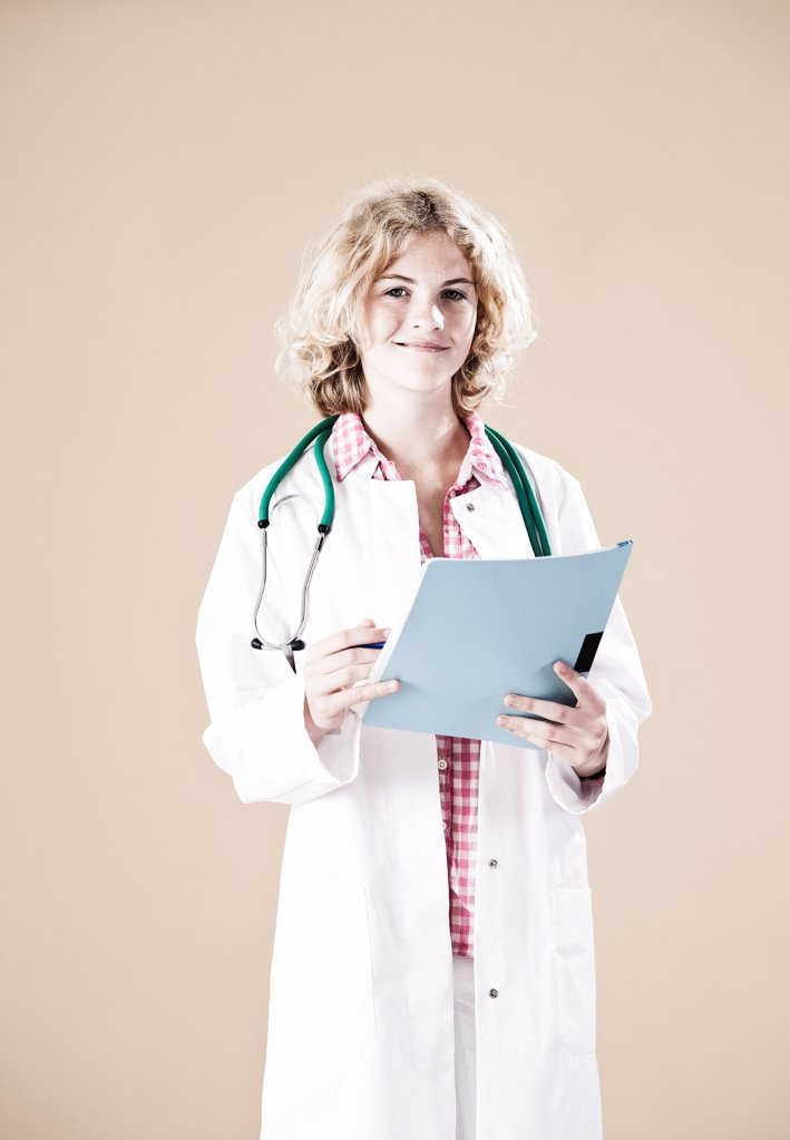Stock Photo: 1841R-124954 Teenage girl with lab coat and sthethoscope
