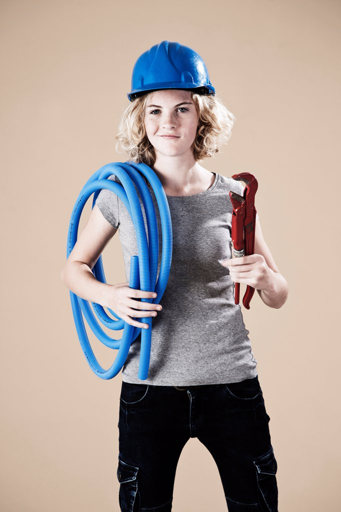 Teenage girl with hard helm and tube : Stock Photo