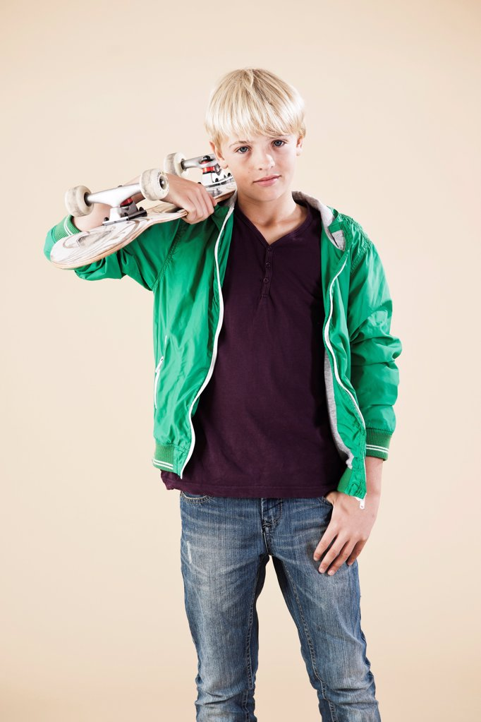 Stock Photo: 1841R-124973 Blond boy with skateboard
