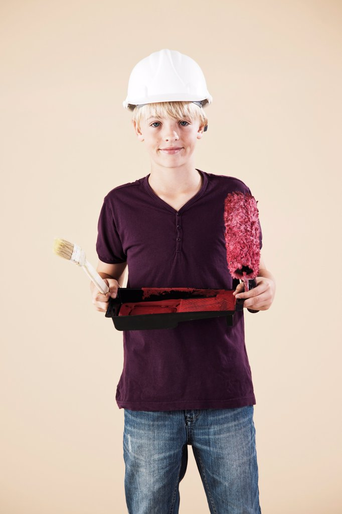 Boy with hard helm and brush : Stock Photo