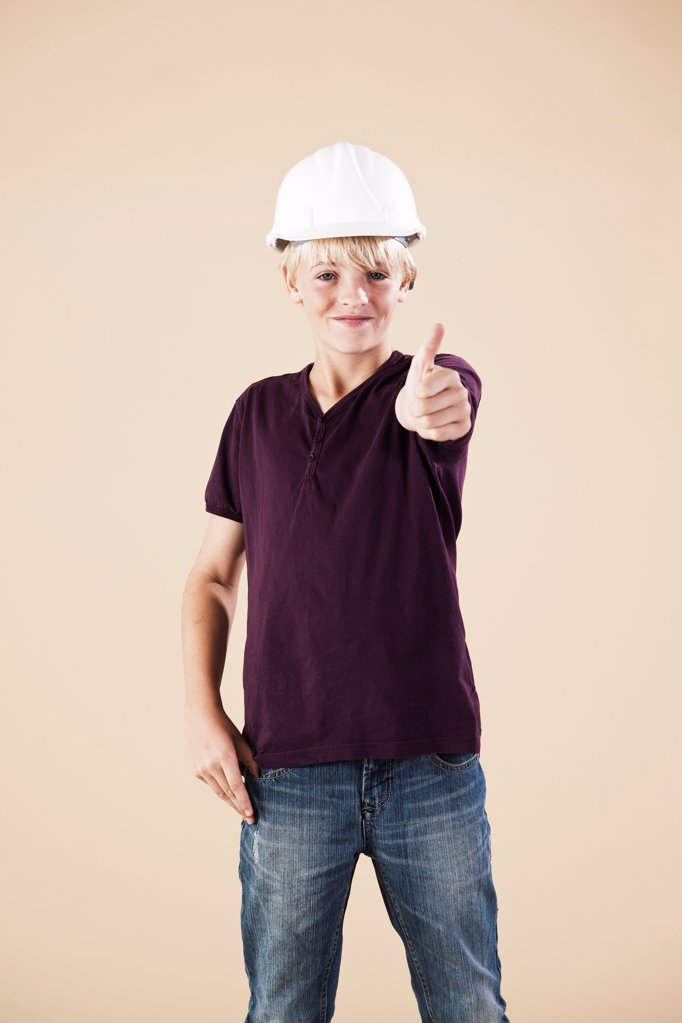 Stock Photo: 1841R-124980 Boy with hard helm and thumbs up