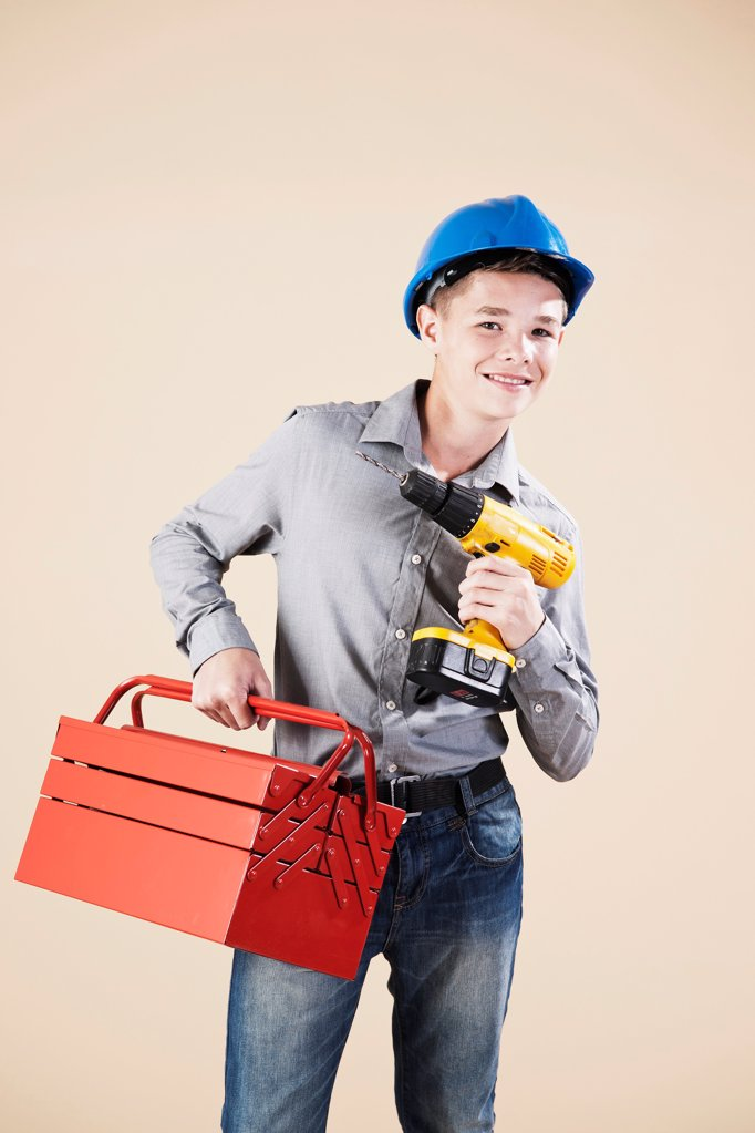Teenage boy with hard helm and tool box : Stock Photo