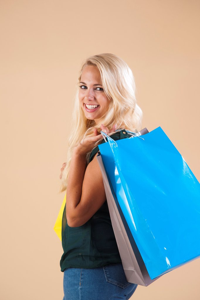 Stock Photo: 1841R-125008 Young woman with shopping bags