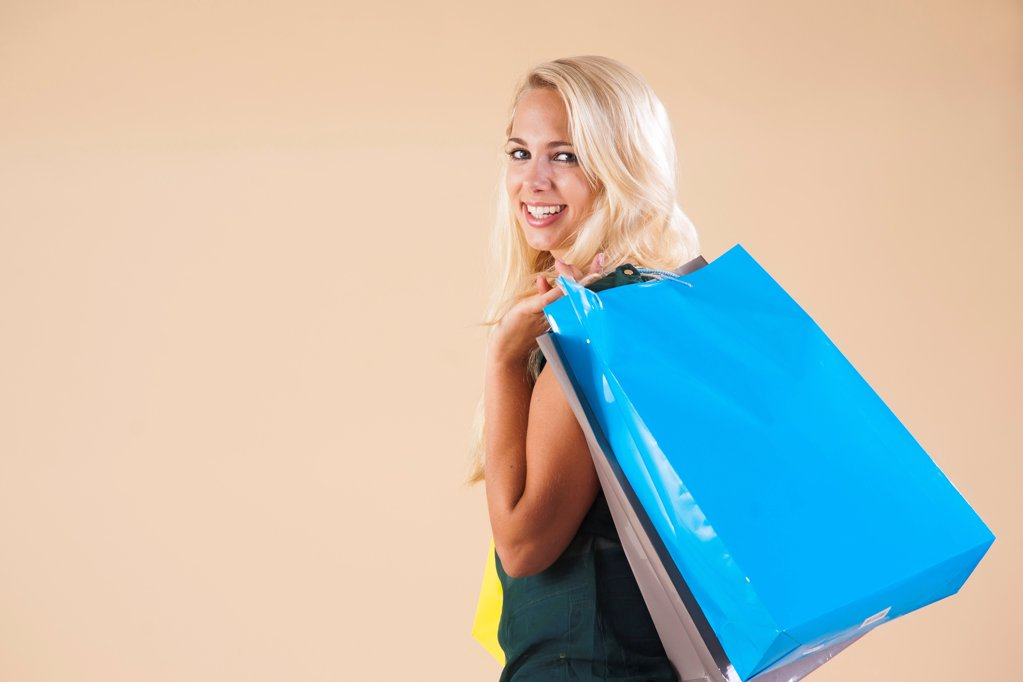 Stock Photo: 1841R-125009 Young woman with shopping bags