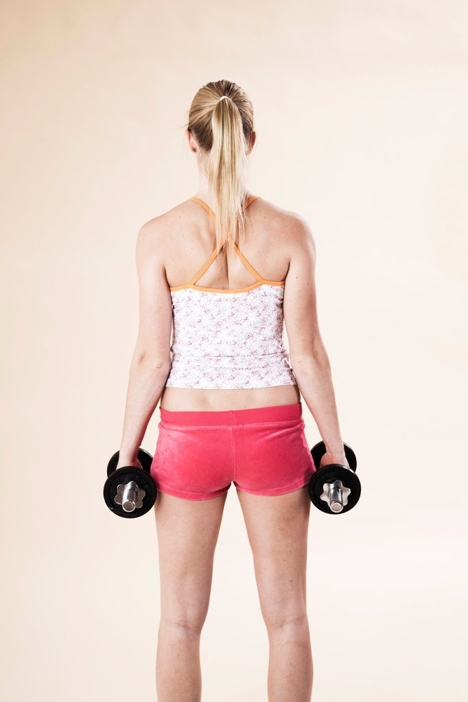 Stock Photo: 1841R-125021 Young woman doing fitness training