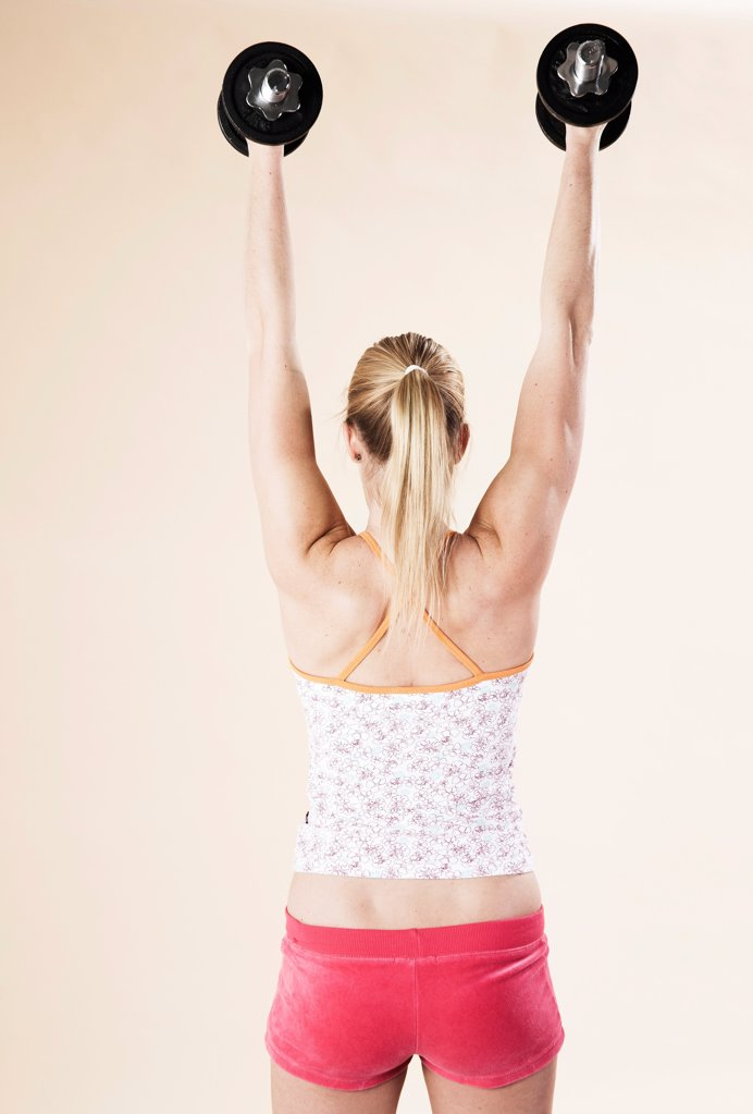 Young woman doing fitness training : Stock Photo