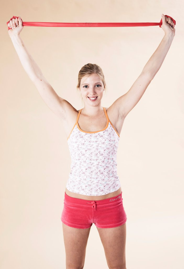 Stock Photo: 1841R-125025 Young woman doing fitness training