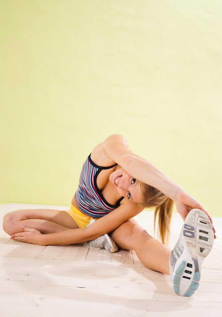 Stock Photo: 1841R-125044 Young woman doing fitness training