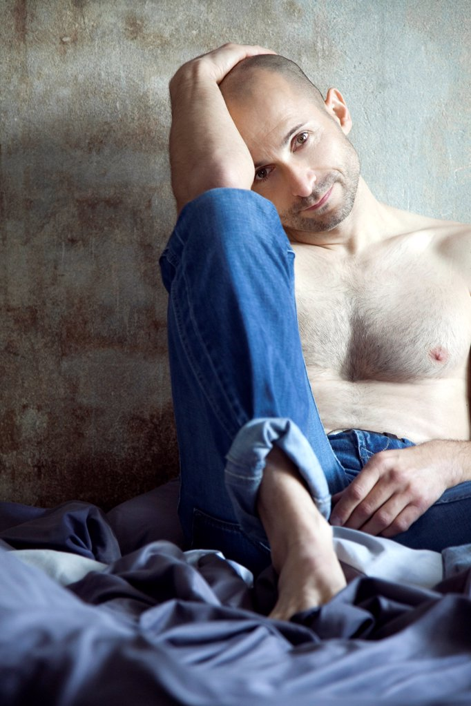 Stock Photo: 1841R-125082 Barechested man with designer stubbles on bed