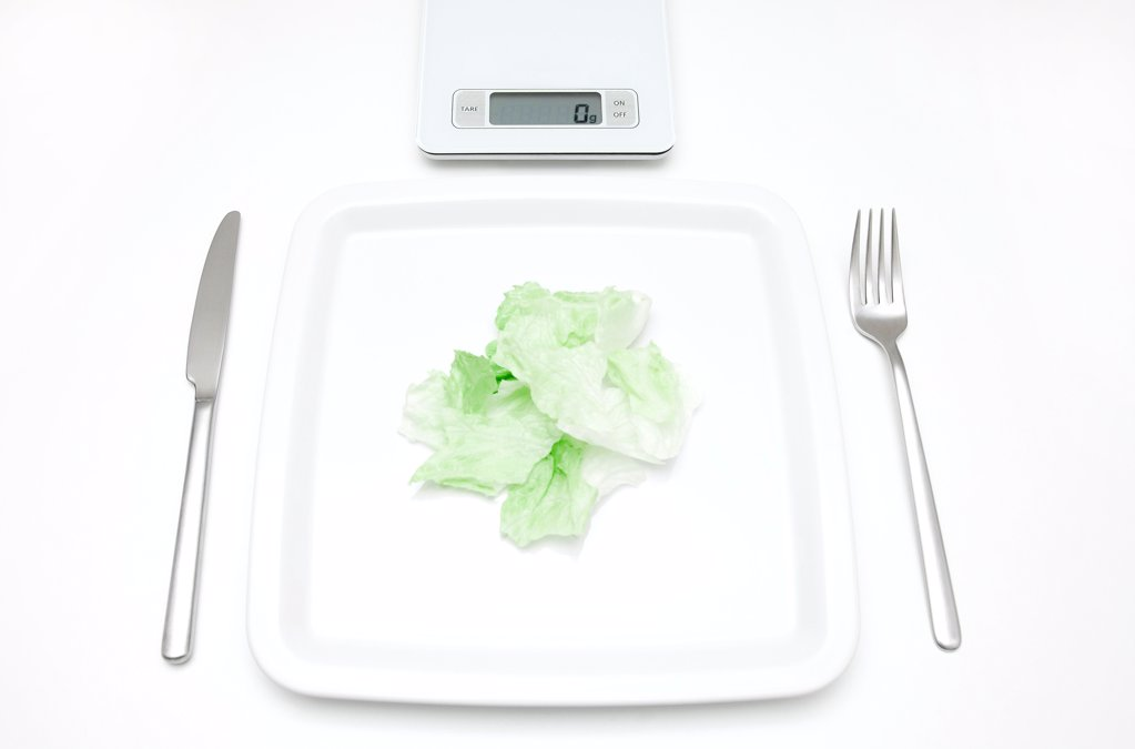 Plate with salad and scales : Stock Photo