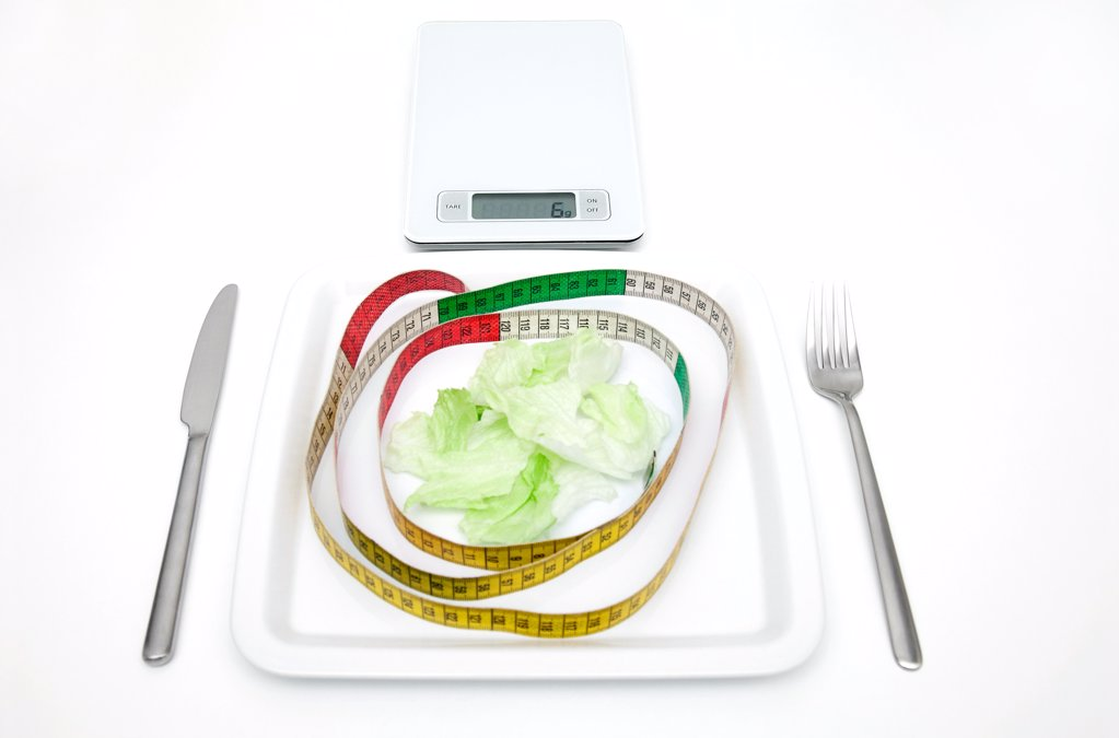 Plate with salad, scales and tape measure : Stock Photo