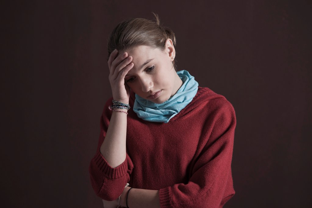 Stock Photo: 1841R-125121 Teenage girl looking pensive