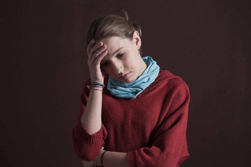 Teenage girl looking pensive : Stock Photo