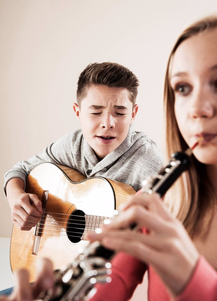 Teenager playing music : Stock Photo