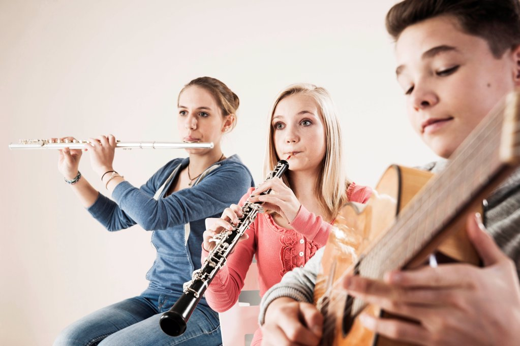 Stock Photo: 1841R-125126 Teenager playing music