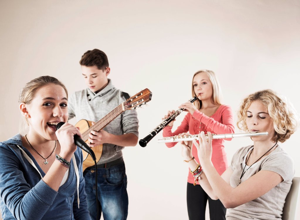 Stock Photo: 1841R-125128 Teenager playing music