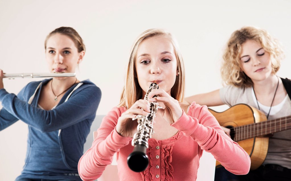 Stock Photo: 1841R-125136 Teenager playing music